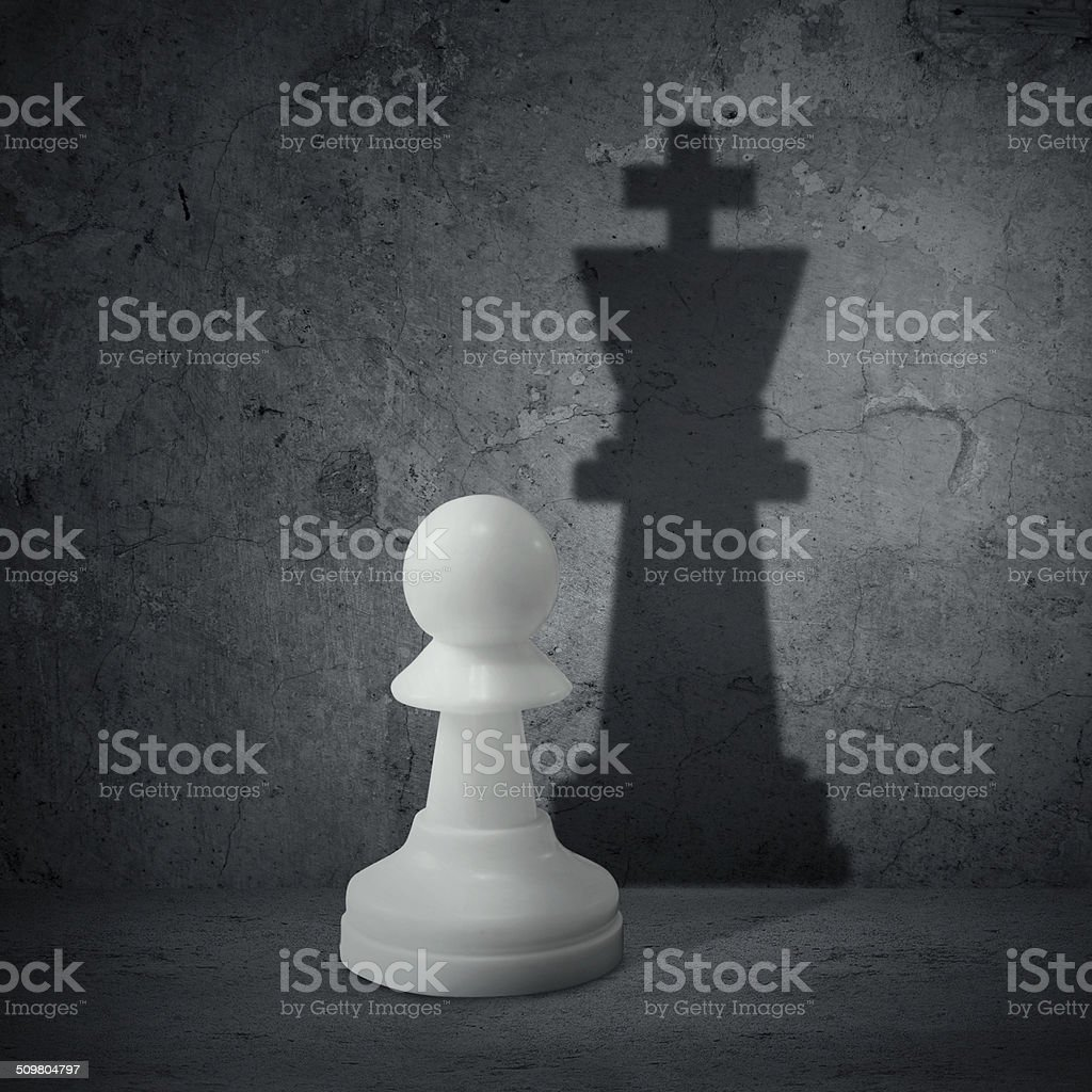 White chess pawn with shadow queen stock photo
