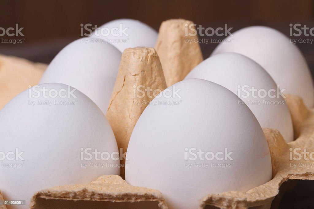 White chicken eggs in a tray macro. stock photo