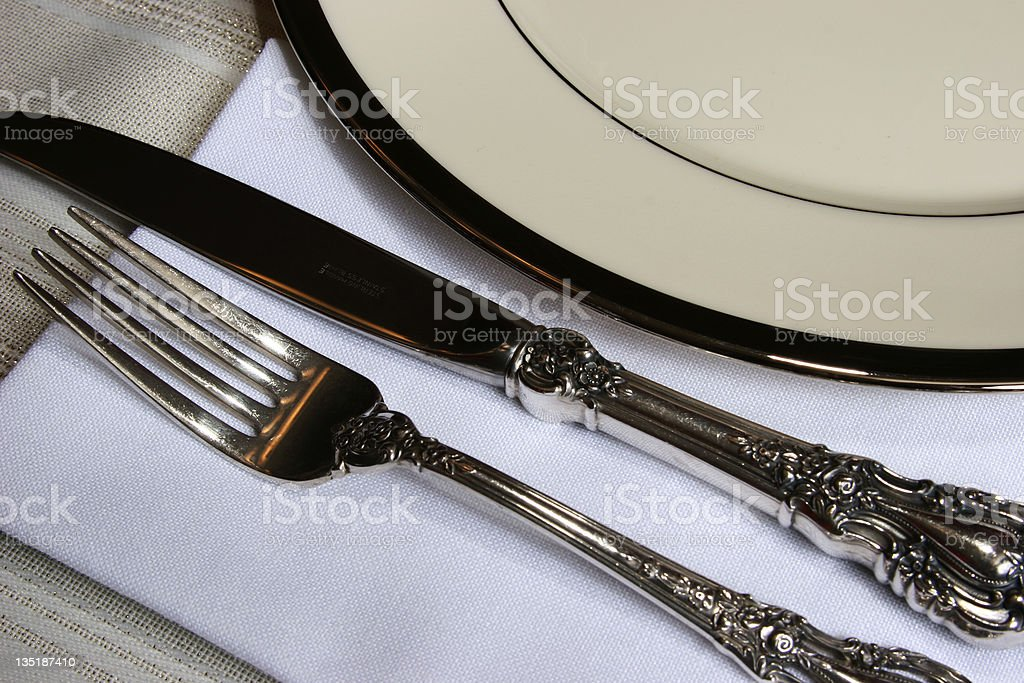 White china and silver place setting. royalty-free stock photo