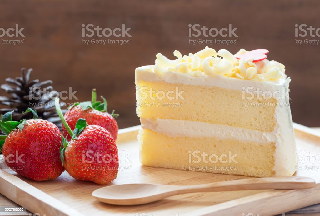 White Chocolate and Strawberry's placed a wooden tray and spoon. stock photo