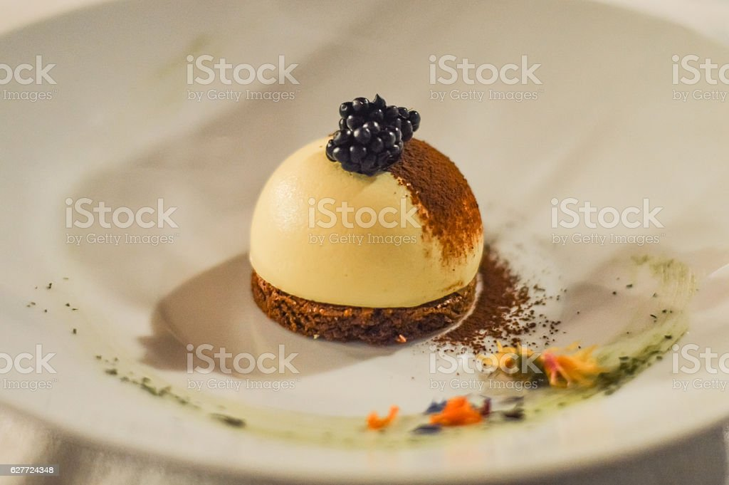 white chocolate pudding half spere on brownie cookie stock photo