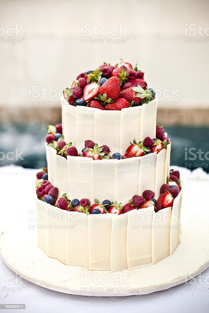 White chocolate wedding cake with berries stock photo