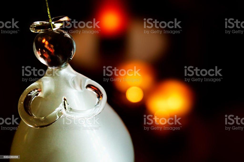 White Christmas Angel Against Blur Lights stock photo