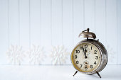 White Christmas background with old alarm clock - copy space