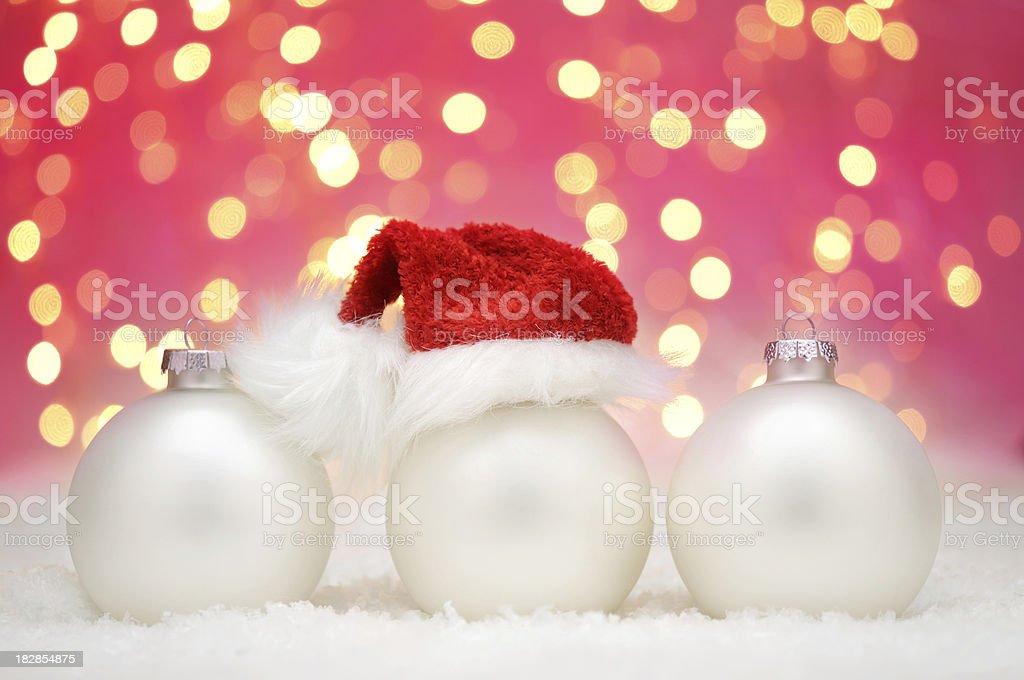 White christmas balls with santa hat royalty-free stock photo