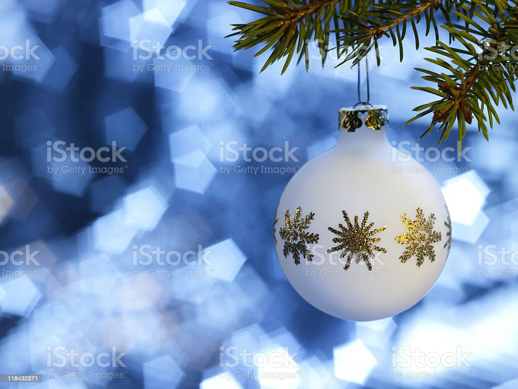 white Christmas bauble in blue back royalty-free stock photo