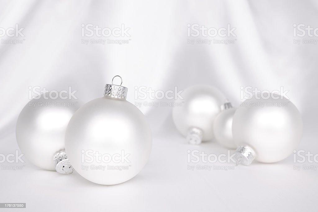 White Christmas Baubles On Satin royalty-free stock photo