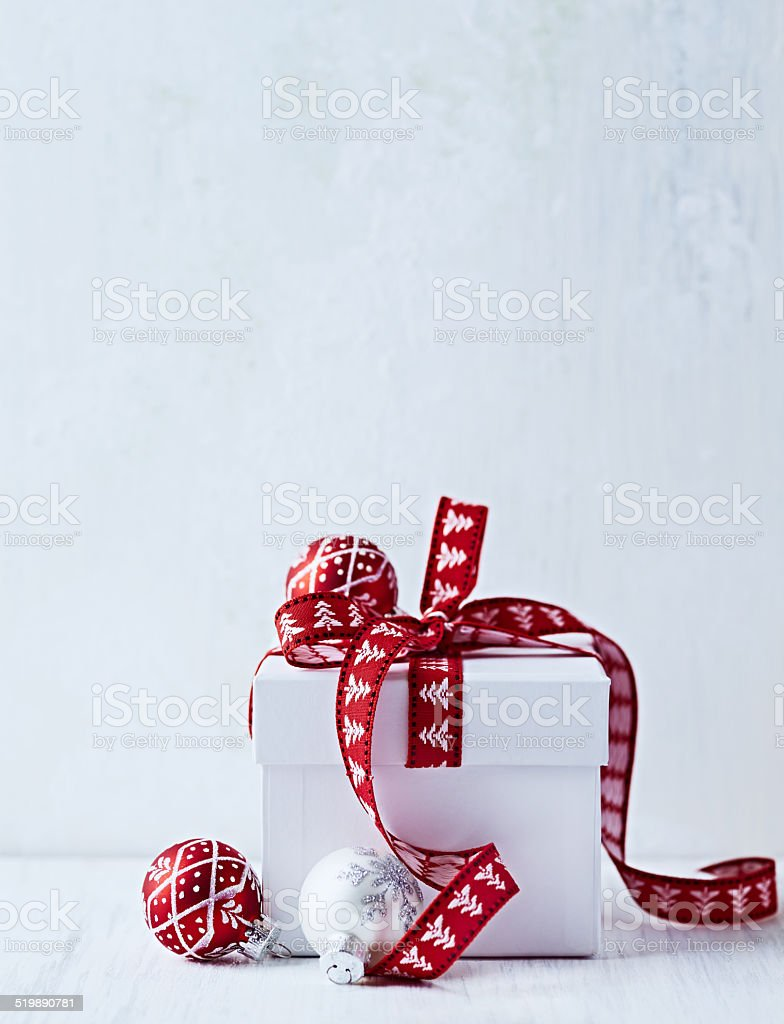 White Christmas Gift with Red Ribbon stock photo