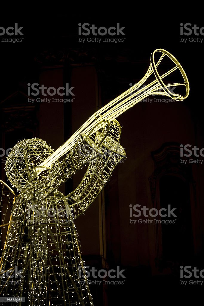 White Christmas lights form Angel with Trumpet in Prague royalty-free stock photo