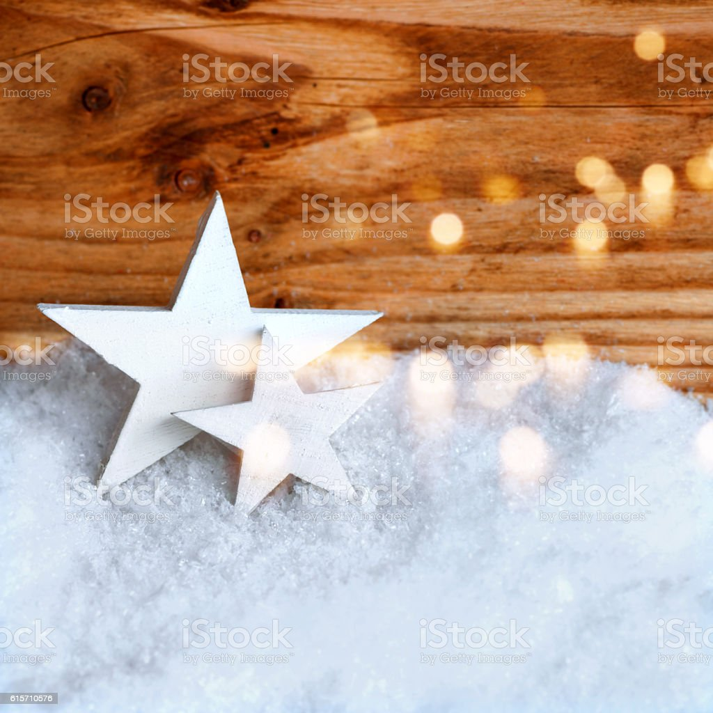 White christmas stars in the snow stock photo