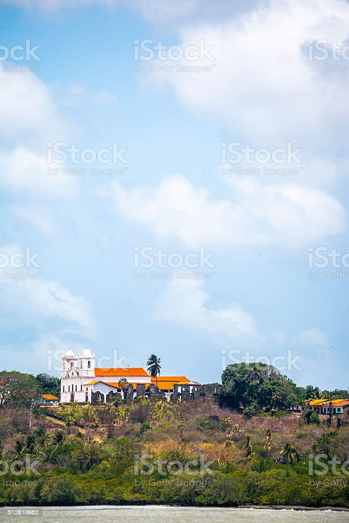 White church on riverside. Alcantara, Maranhao, Brazil. stock photo