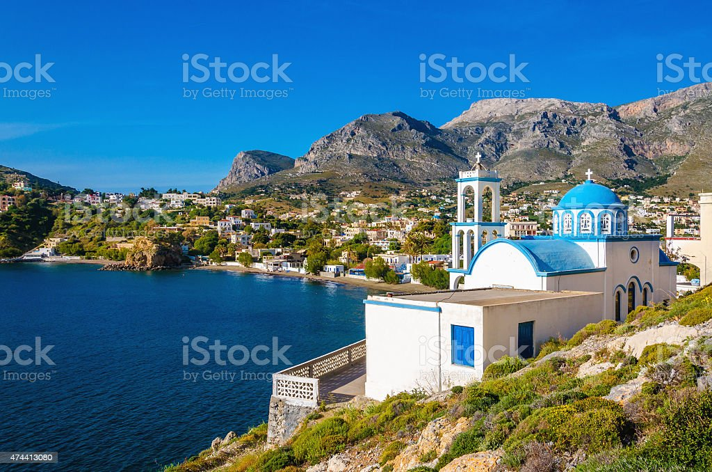 White church with azure blue dome Island, Greece stock photo