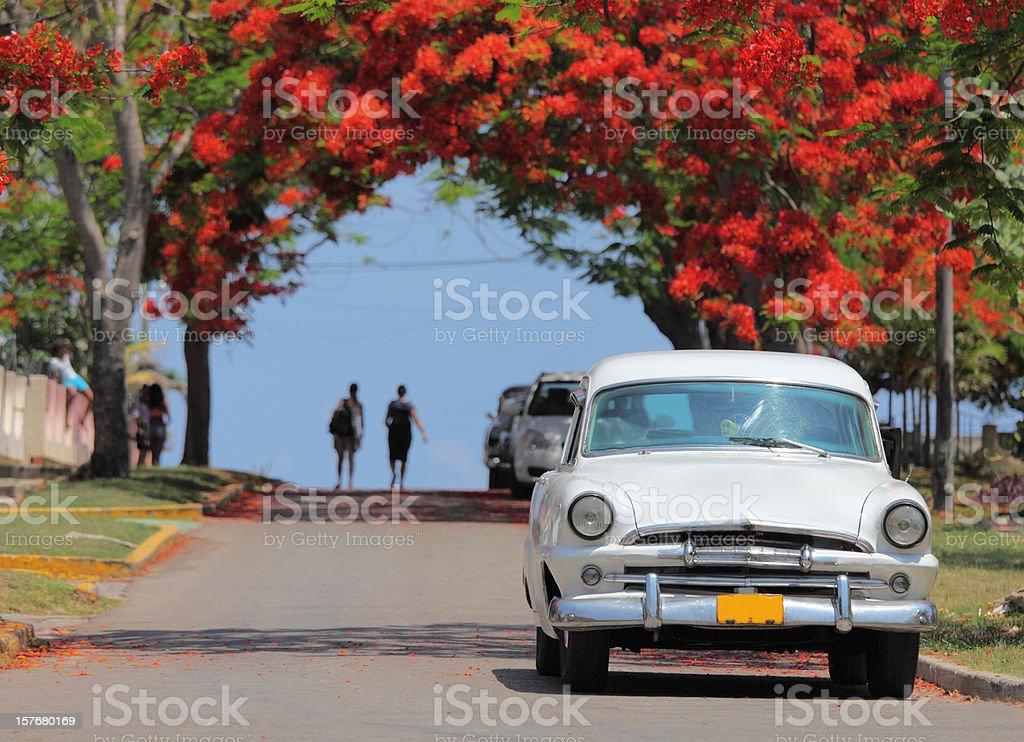 white classic vintage cuban car and pedestrians stock photo