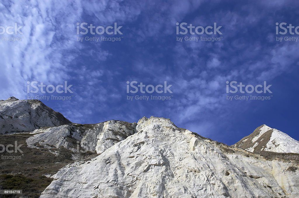 White cliffs amongst a cloudy blue sky royalty-free stock photo