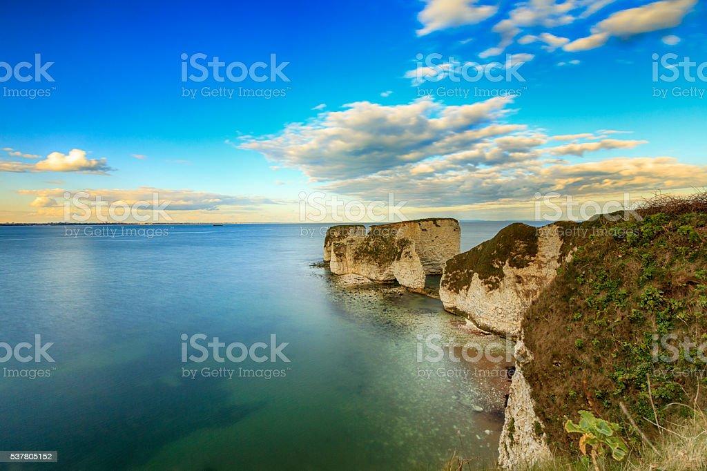 White cliffs in emerald sea stock photo