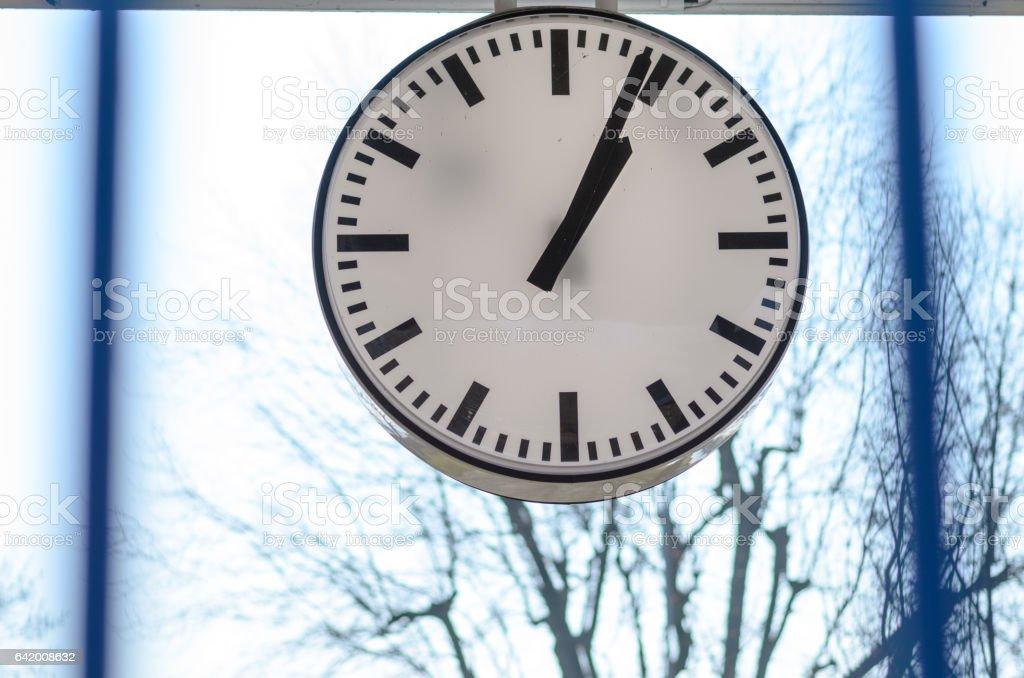 White clock against window stock photo