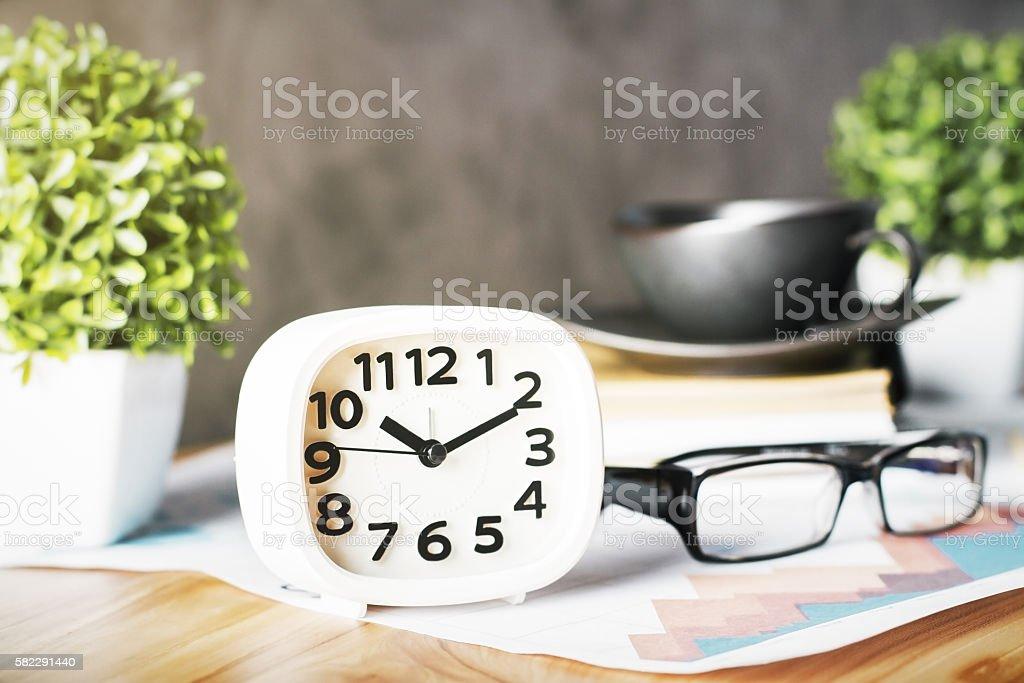 White clock and glasses stock photo