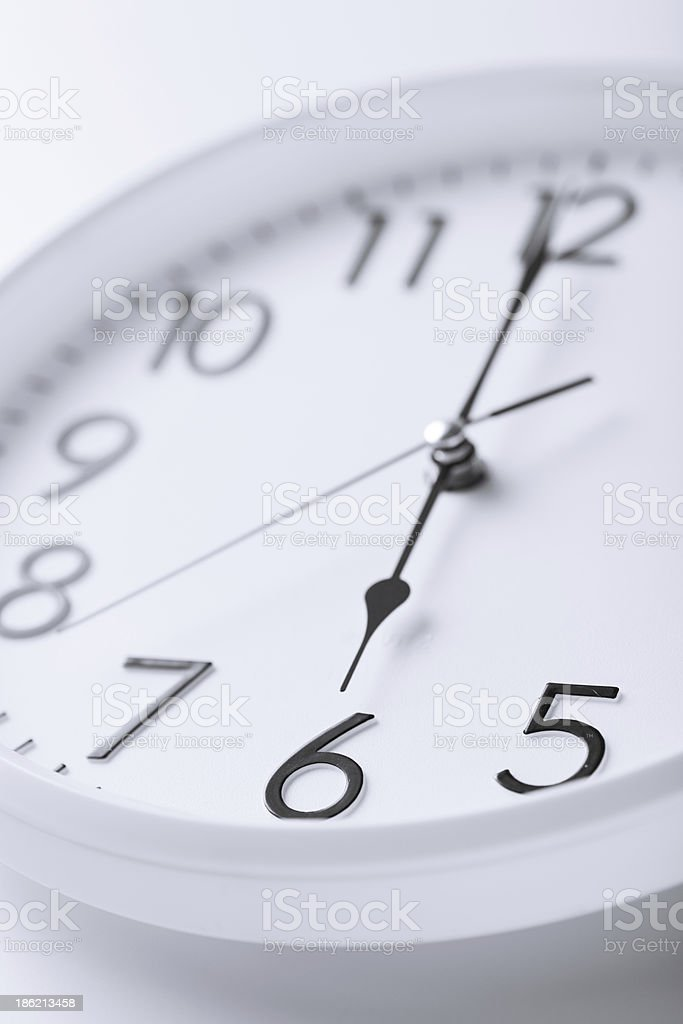 white clock showing six o'clock royalty-free stock photo