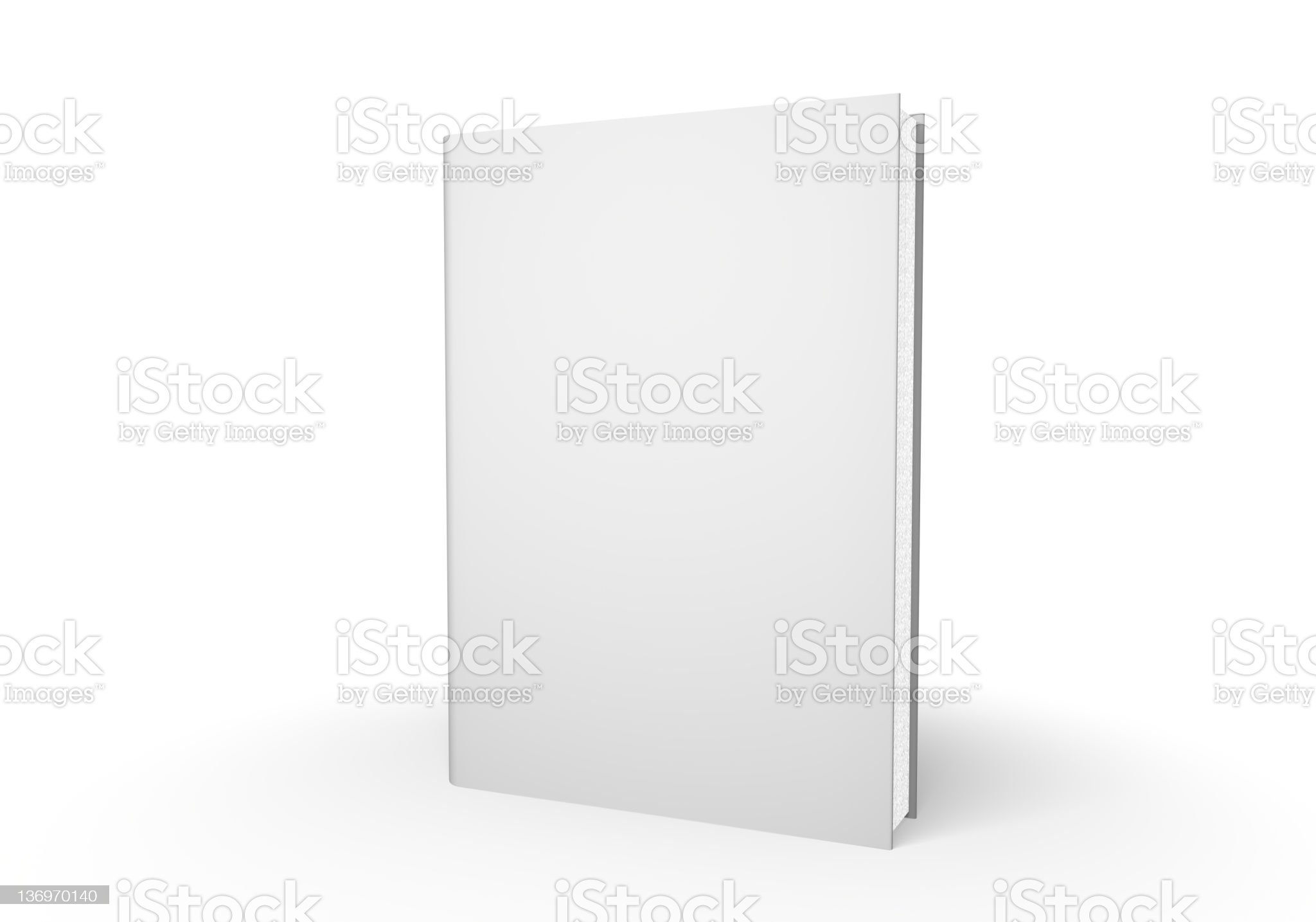 White closed book standing on a white table royalty-free stock photo