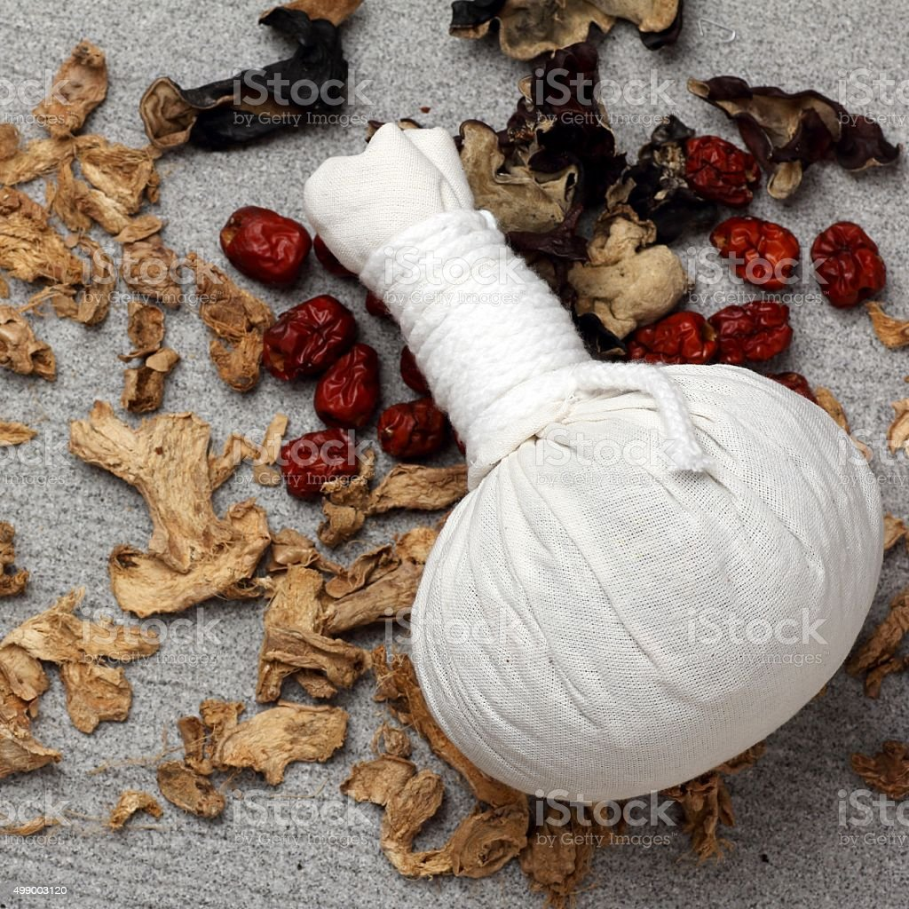 white cloth herbal compress ball stock photo