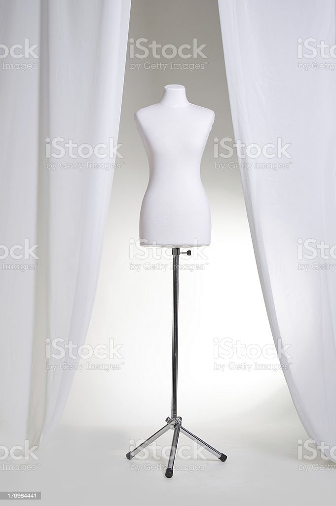 White clothing mannequin on a light background near the curtains royalty-free stock photo
