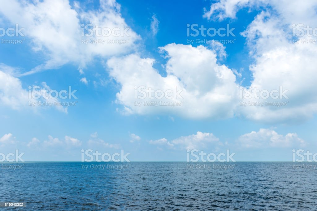 White cloud on the blue sky with sea background stock photo