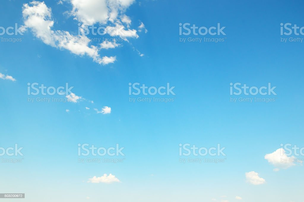 white  clouds against the blue sky stock photo