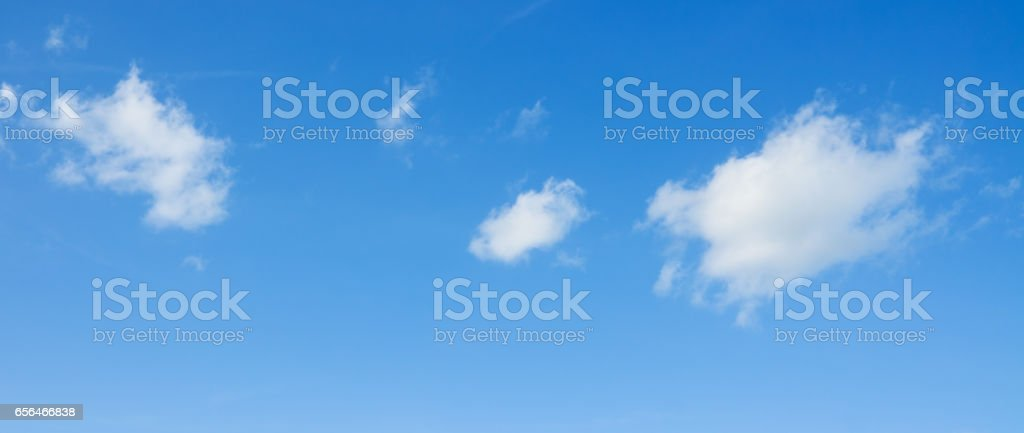 White clouds flying against blue sky. stock photo