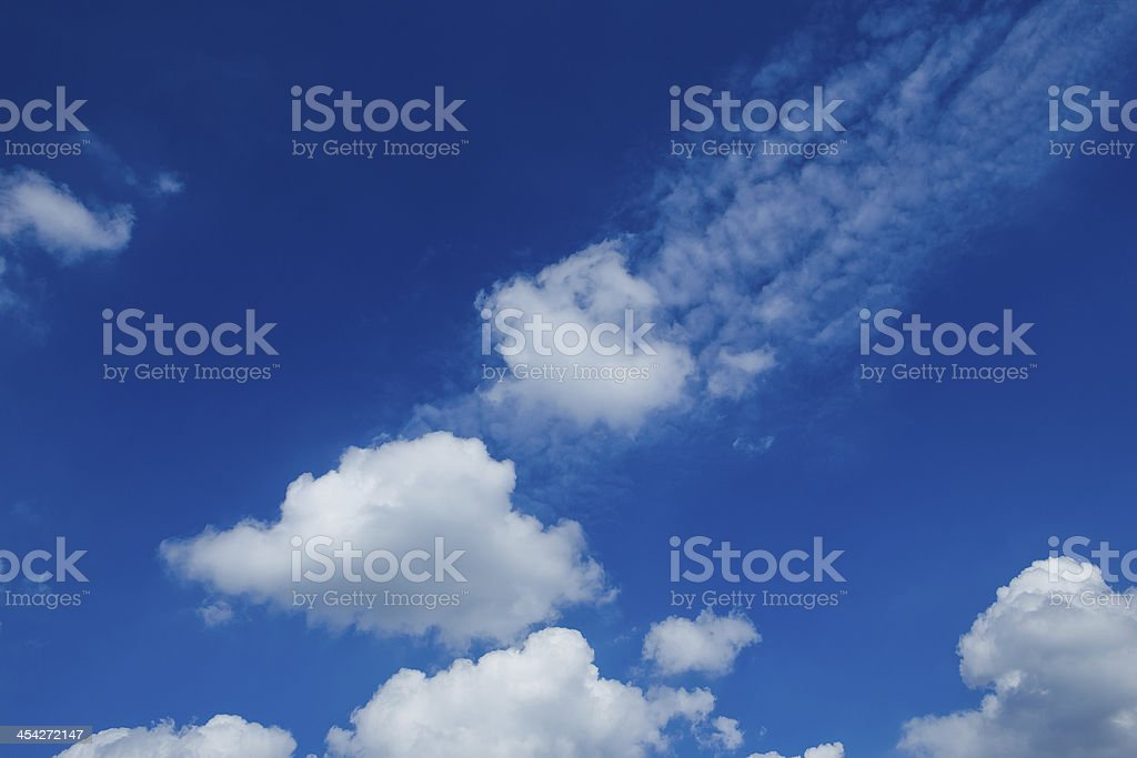 White clouds in a blue sky. Sky background royalty-free stock photo