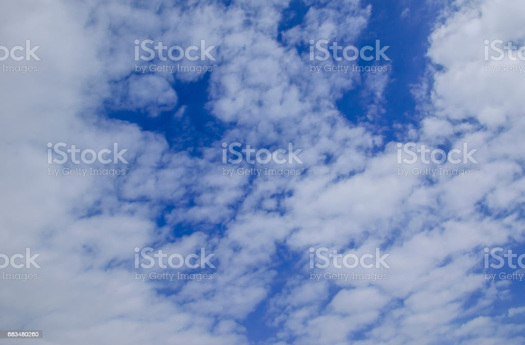 White clouds in deep blue sky stock photo
