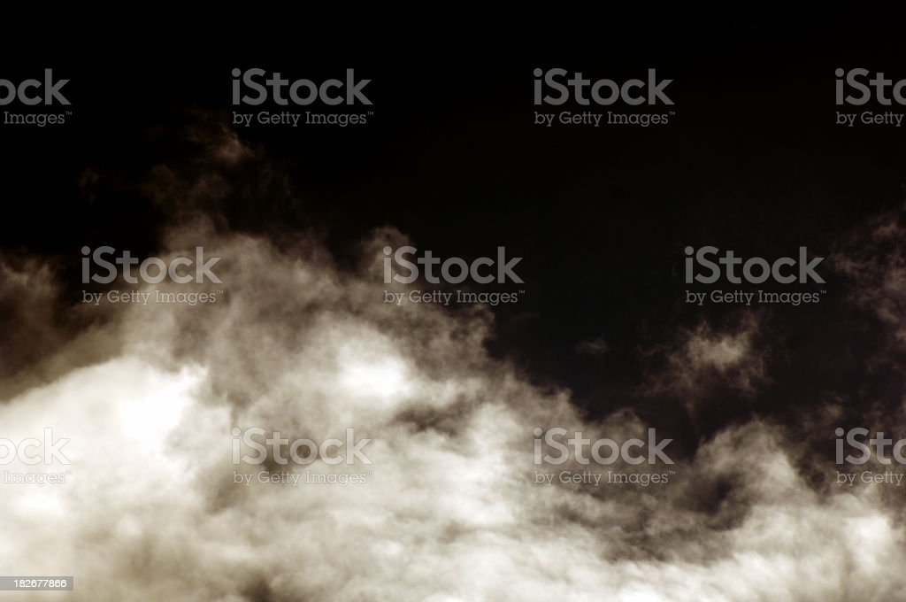 White clouds of smoke on a black background stock photo