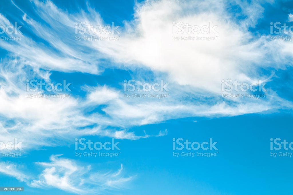 White clouds on blue sky textured background with wind stock photo