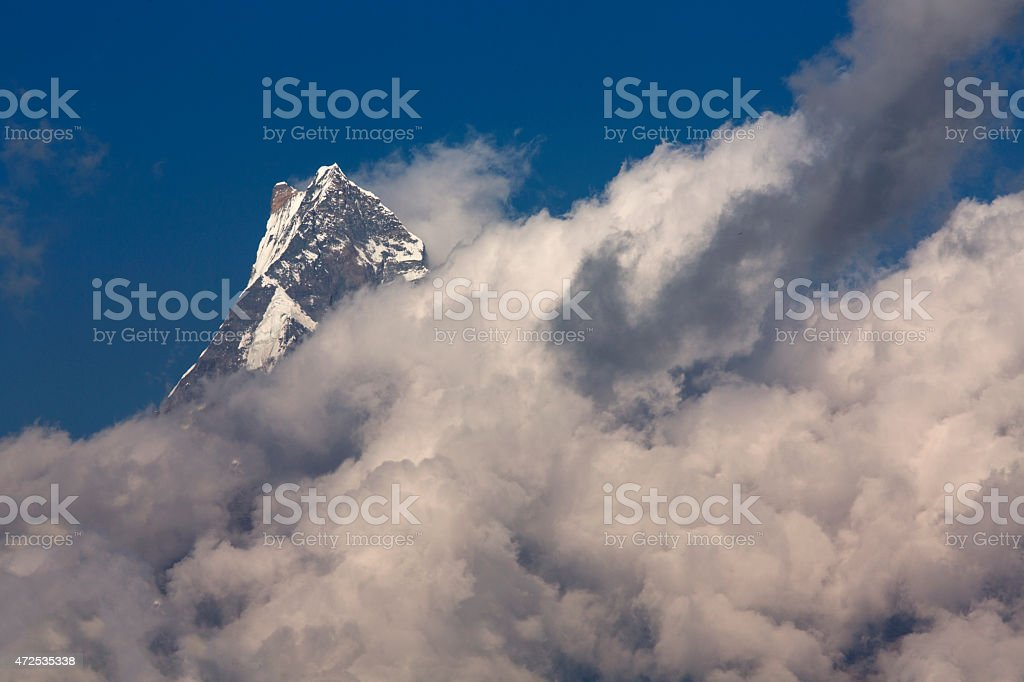 White clouds over Machhapuchchhre mountain - Fish Tail in Englis stock photo