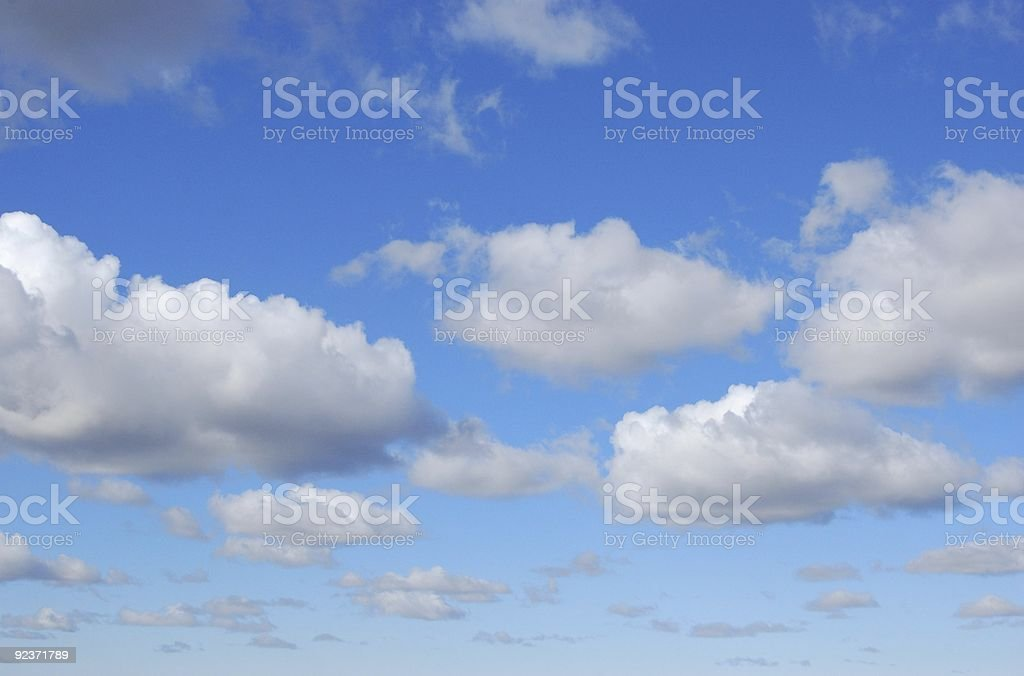 White Clouds with a dark cloud royalty-free stock photo
