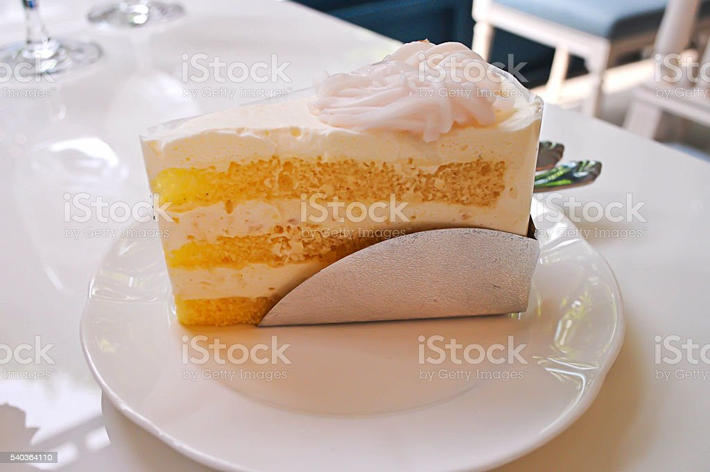 White coconut cake on wood dish the delicious. stock photo