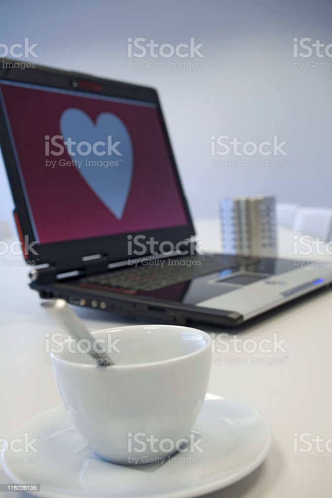 white coffee cup and heart shape on a computer monitor royalty-free stock photo
