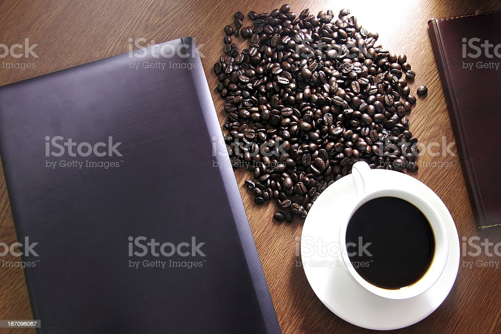 White coffee cup high angle and see computer. stock photo