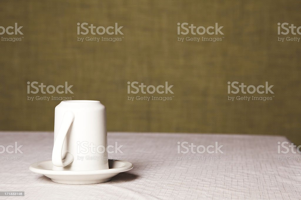 White coffee cup upside down stock photo