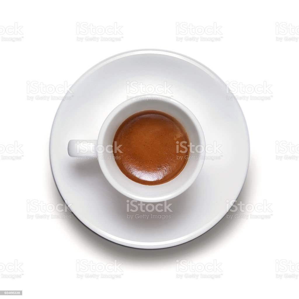 A white coffee cup with a white expresso inside royalty-free stock photo