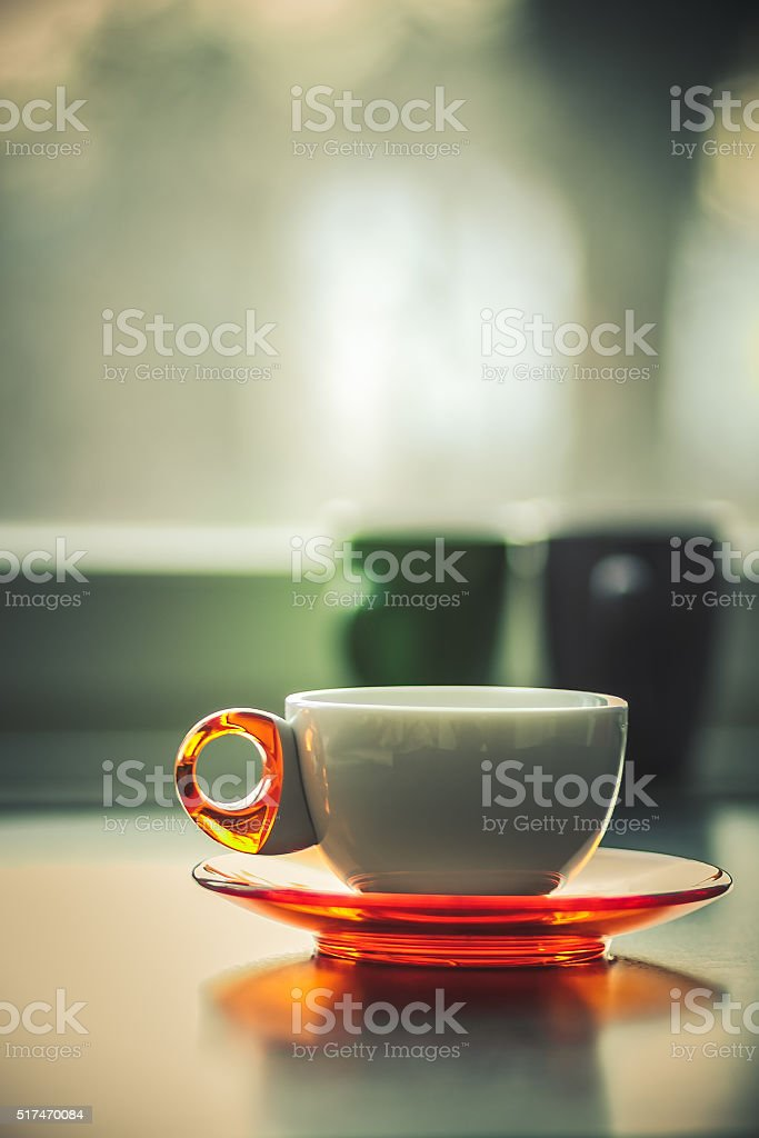 White coffee tea cup in front of window matte stock photo