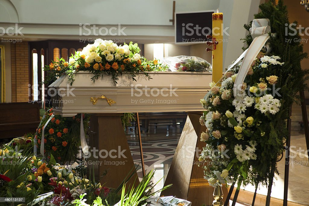 White Coffin, wreaths in the Catholic Church stock photo
