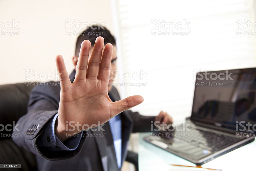 White collar Crime.  Businessman not wanting his picture taken. stock photo