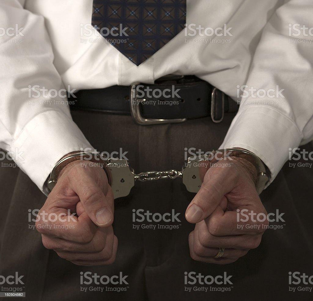 white collar criminal under arrest stock photo