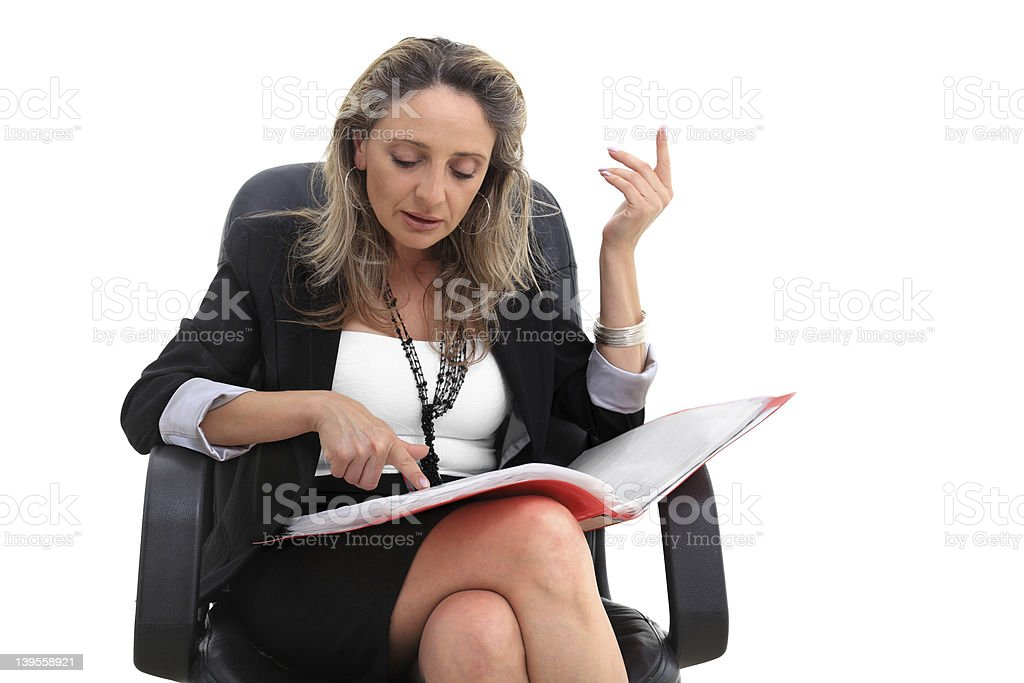 White Collar Worker sits in armchair studying documents royalty-free stock photo