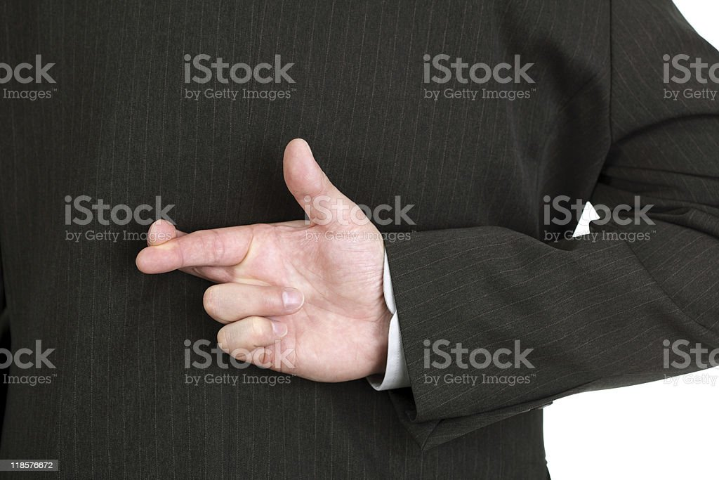 White collar worker telling a lie with fingers crossed stock photo