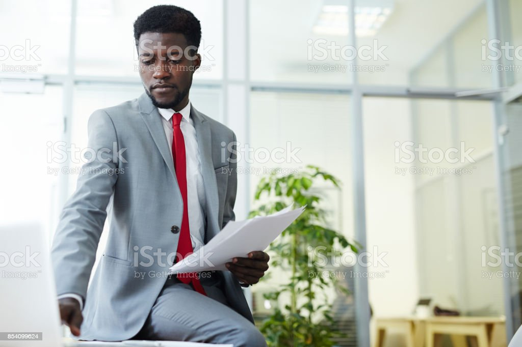 Handsome Africa American white collar worker wearing stylish suit...