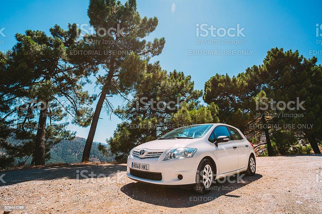 White color Toyota Auris car on Spain nature landscape stock photo