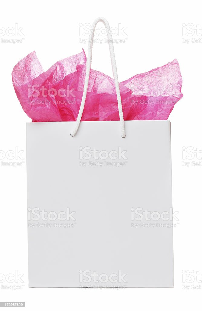 White colored gift back, with pink paper sticking out  stock photo