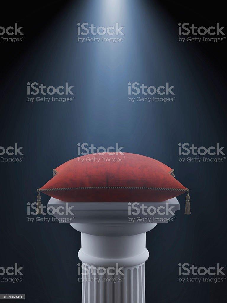 White column with red velvet pillow stock photo