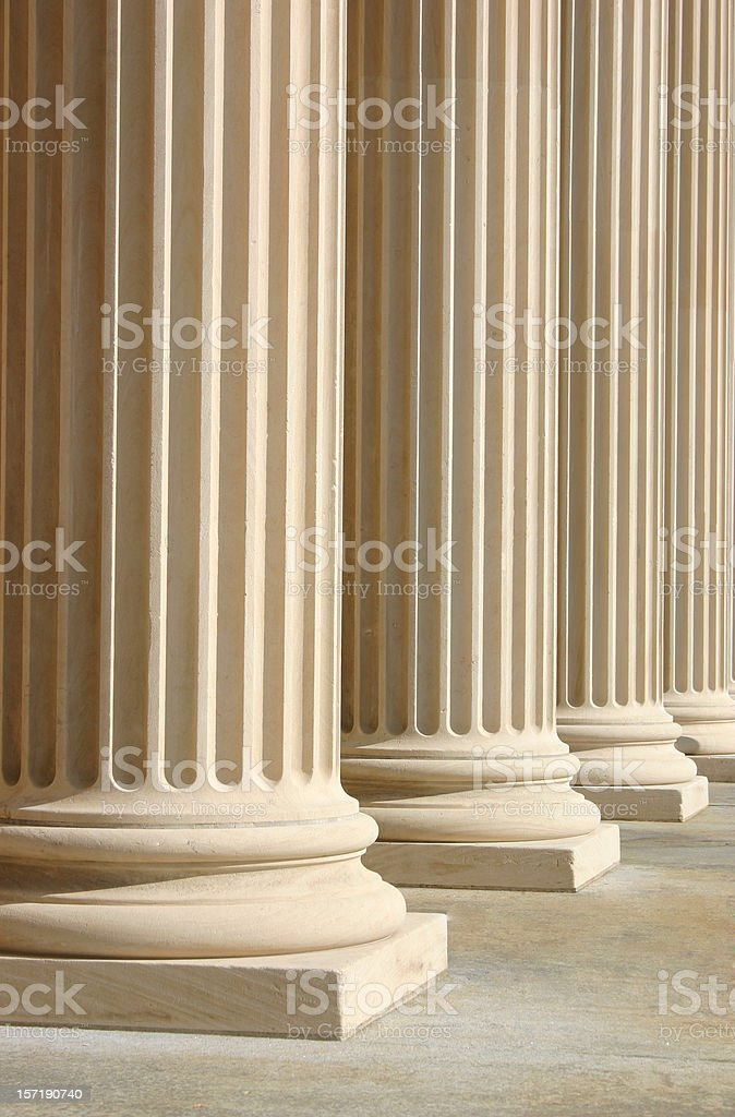 White columns in a row in a building royalty-free stock photo